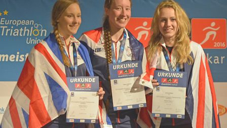 Sisters Amy (left) and Diana Chalmers (centre) on the European Duathlon Championships podium with br