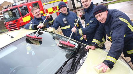 (L-R) St Ives firefighters, Phil Thacker, John Murphy, Lee Parnell and Gordan Grant wash cars for ch
