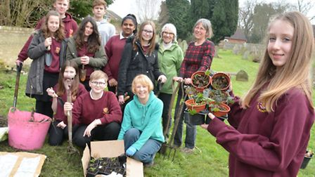 Eco Ivo Club are planting flowers, at Westwood Road Cemetry, St Ives, with (front) Jemima,