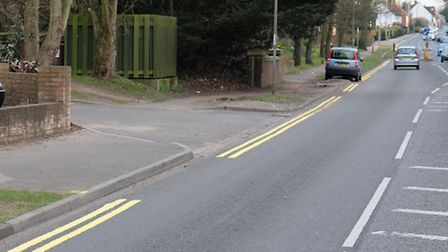 Gaps in double yellow lines painted on Watling Street caused by parked cars
