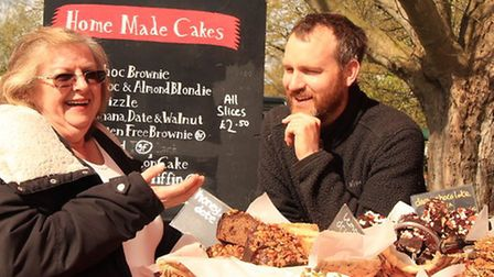 Andrea Thompson of Royston being tempted with Ben Jones's sumptuous selection of home made cakes. P