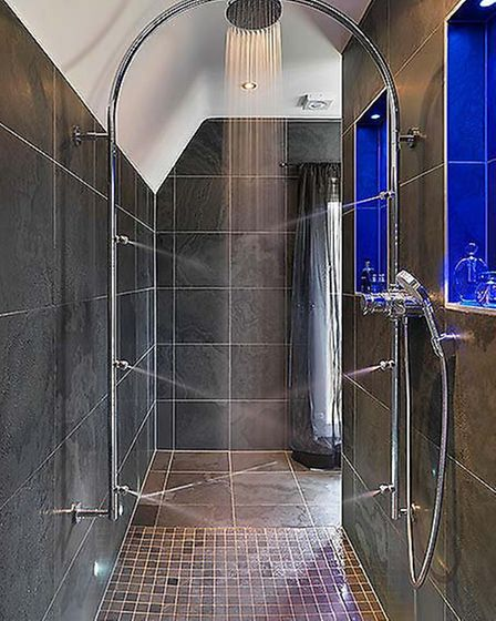 Think about creating a shower recess to store your bottles that might normally clutter the floor of