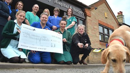 Cromwell Vetinary Hospital & Surgery, Huntingdon, presents a cheque for £2000 to Medical Detection D