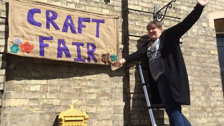 Laura Whitford with her new hand-made banner.