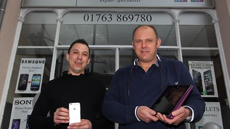 Owners, Tim Haynes and James Bloomfield outside their repair phone/tablet shop in Royston
