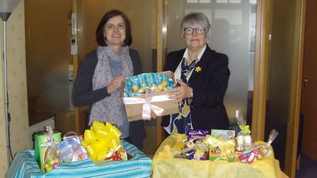 Jackie Cotton from Home-Start receiving the eggs from Trudy Lambert of Cecil Newling.