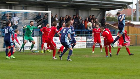 Tom Ward gets in a header for St Neots Town against Frome. Picture: CLAIRE HOWES