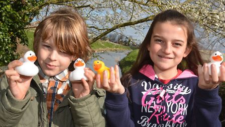 preparing for Ramsey Duck Race, are (l-r) Henry Gilbert, and Alice Buckle, from Ramsey, with their d