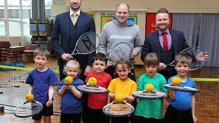 Dan Smith, tennis coach, (centre) with David Tate and Stuart Cassidy and pupils from Redbourn Infant