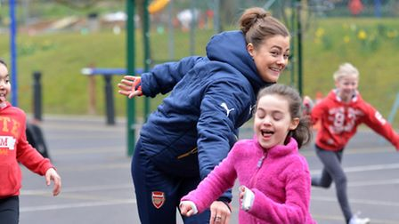 Jemma Rose from Arsenal Ladies trains the children