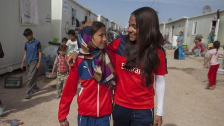 Arsenal Ladies' captain and Lioness Alex Scott meets Yasmine, 12 years old, who has been helped by