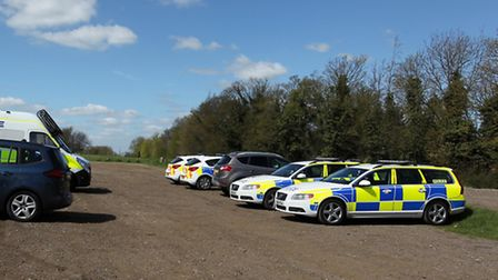 Police cars on Royston Heath during the search of the missing author's house.
