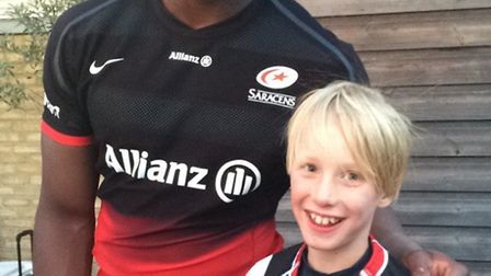 Saracens and England star Maro Itoje with Harpenden junior Henry Penstone
