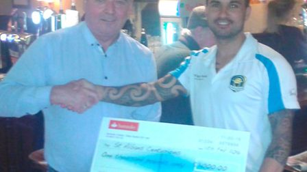 John McGuinness, landlord of the White Swan who are sponsoring the club, with Centurions' player Tim