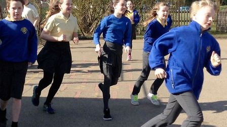 Pupils at the school taking part in the mile in Chrishall.
