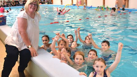 50 Years in Huntingdon Swimming, Patsy Coleman, at the Splash Academy, with some of her class,