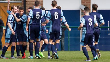 St Neots players celebrate Drew Roberts' goal in their 1-1 draw with Cambridge City. Picture: CLAIRE