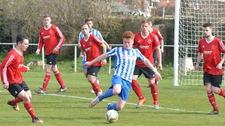 Five opponents paying attention to Alex Marsh during Eynesbury Rovers' victory against Rothwell Cori