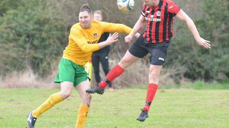 Action from Houghton & Wyton's important win at Fenstanton. Picture: HELEN DRAKE