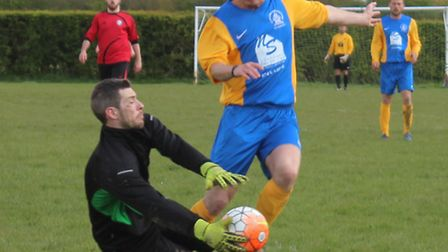 Cannon Res keeper comes out to save at the feet of a Breakspear forward
