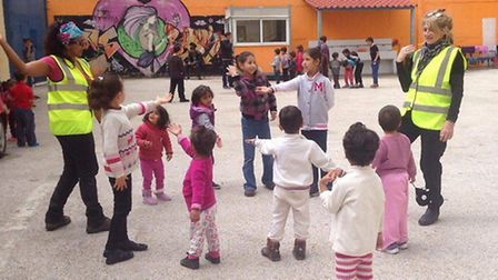 Sumita (right) engaging some of the refugee children in a dance class