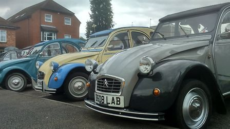 Classic cars lined up in the car park.