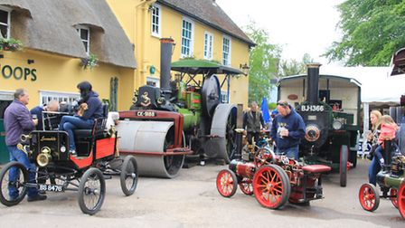 Spectators came to Bassingbourn to check out the steam engines at The Hoops pub. Picture: Clive Port
