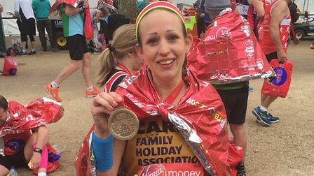 Carrie Taylor ran the marathon for the Family Holiday Association.