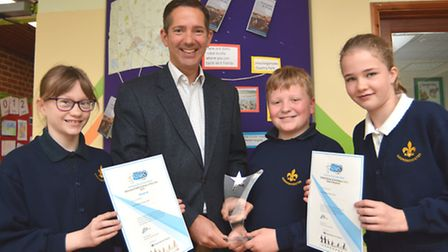 MP Jonathan Djanogly, presents pupils from Godmanchester Primary School (l-r) Emma, Matthew, and Ame