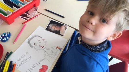 Therfield pupil Joshua McNaught, aged 6, shows off his drawing of Her Majesty.