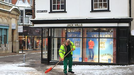 St Albans was hit with snow this afternoon (April 26) - here a worker shovels snow to clear the pav