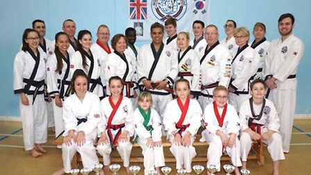 Huntingdon and St Ives Tang Soo Do Association members show off their trophies won at the National C