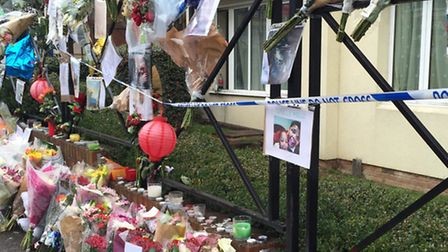 Flower, candles, beer bottles and messages on London Road