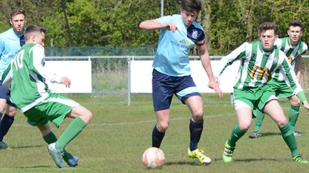 Captain Taylor Parr on the ball for Godmanchester Rovers during their victory against Whitton United