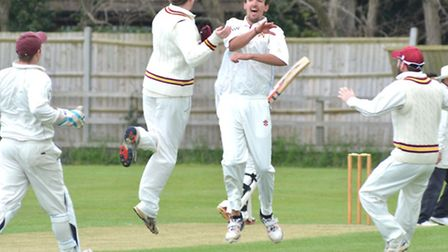 Waresley bowler Alex Watkiss celebrates a wicket during his side's defeat to Ramsey yesterday. Pictu