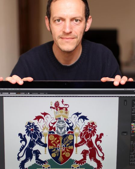 Quentin Peacock with the coat of arms which he designed for the new Olympic kit