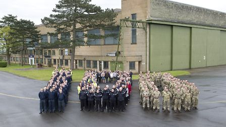 Group photo of station personnel at Wyton spelling 100 to mark 100 years of Wyton Airfield