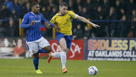 Shaun Lucien battles with Lee Chappell during Saints 1-0 win over Wealdstone in November. Picture: L