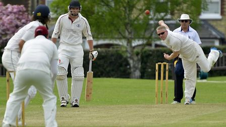 Captain Martin Burton bowling for Huntingdon & District during their victory against March. Picture: