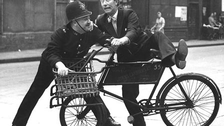 Richard Hearne (r) and Philip Stainton (l) struggle over a stolen bicycle during the open-air filmin