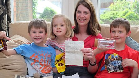 Jane Walker with her children (L-R) Ben, 7, Martha, 3 and Sam, 9 found a time capsule underneath the