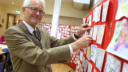 The Mayor of St Ives, Councillor Ian Jackson puts up some childrens artwork at the Book Jam event in