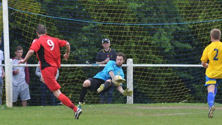 Charlie May makes a save from Harry Bushel