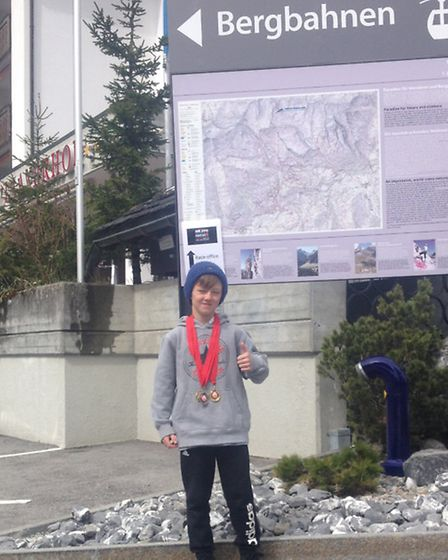 Liam Tynan with his medals in Laax