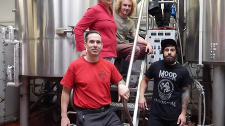 Justin Hawke, his wife Maryann and the brewing team at Moor Beer