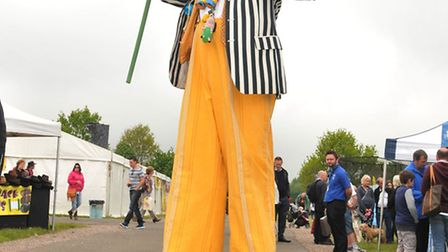 A man on stilts at the Herts County show