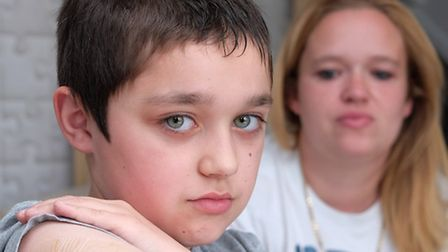 Sam Davis' son Kyle, 10 was attacked and bitten on the arm by a dog and are calling for more to be d