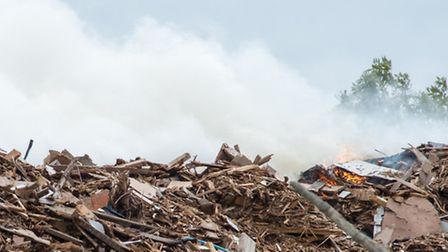 Firefighters spent days tackling a blaze in a large pile of wood in Mountnessing, Essex. Photo court