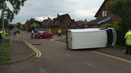 A van overturned after the crash at the junction between Lower Gower Road and Serby Avenue at about