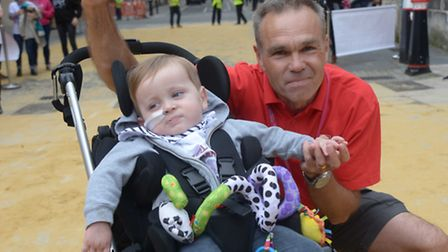 Mark Penfold with grandson Frankie after crossing the finish line